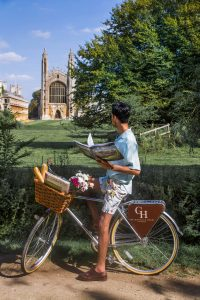 A customer using a Gonville bike in view of King's College, Cambridge