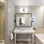 The bathroom in the Delphinium feature room featuring a twin basin