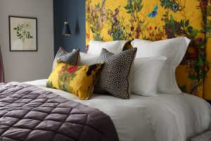 Shot of a bed in one of the Gresham House feature rooms