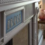 Detail of the restored period fireplace in Delphinium feature bedroom.