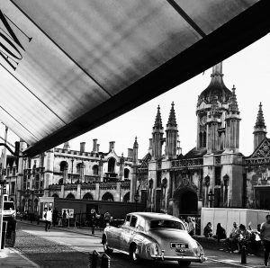 Black and white shot of a Gonville Hotel Bentley outside Kings College, Cambridge