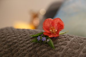Flower on a towel in Gresham House Wellness