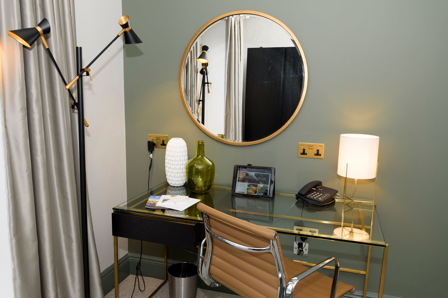 Desk and mirror in a bedroom at Gonville Hotel