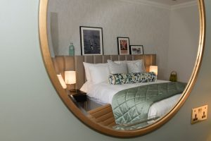 A mirror in a bedroom at Gonville hotel