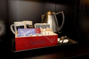 Complimentary tea and coffee in a bedroom at Gonville Hotel