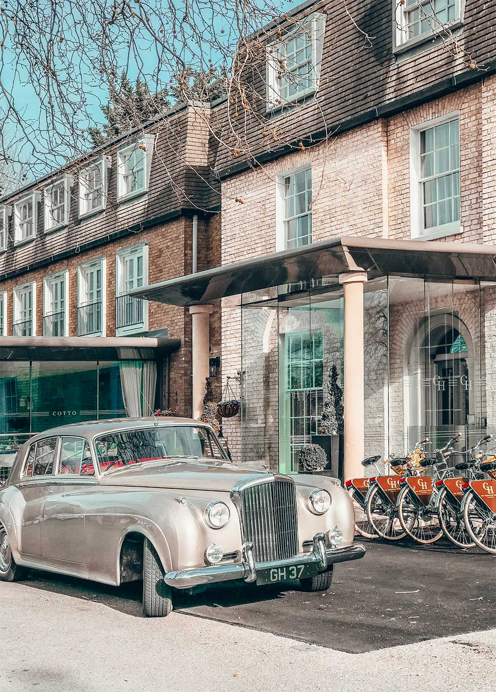 Entrance of Gonville Hotel with Bentley parked outside